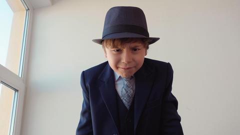 Strict little boy looks like a boss swears on camera Live Action