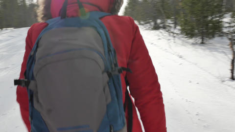 tourist in protective boots with big backpack walks on snow Footage