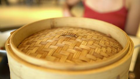 Asian cuisine - typical shanghai chinese food xiao long bao soup filled dumpling Footage