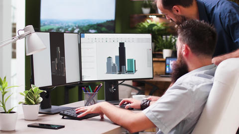 In creative media house two professional architects are using 3D software Footage