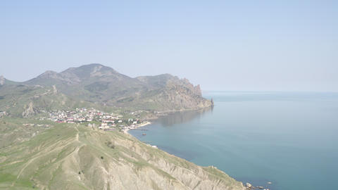 Panoramic air view picturesque bay. Amazing view coast with beautiful resort village among Footage