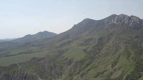 Panoramic air view majestic mountain range. Highlands on hot summer day. Outdoor recreation. Live Action