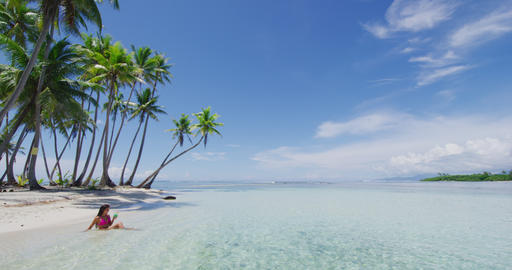 Tahiti cruise private beach island relaxing swimming in water sipping cocktail Live Action