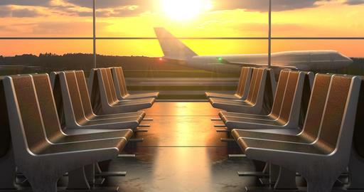 Passenger airplane landing against sunset as seen through departure hall windows Animation