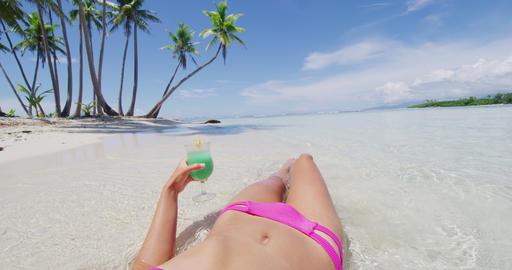 Beach vacation woman sun tanning drinking blue Hawaiian... Stock Video Footage