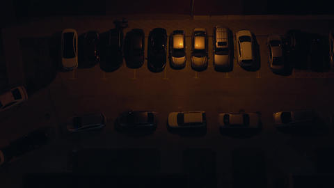 Top view of the parking lot from the roof of a skyscraper at night. Parking by Live Action