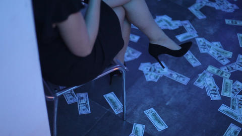 Money is lying on the floor in the club room at a party. People go for the money Live Action