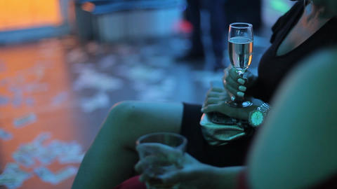 Girl with a glass of white wine in her hand at a party Footage