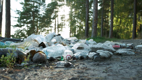 Dirty seashore, plastic bottles, bags and other trash on the sand of the beach Footage