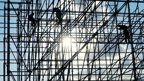 Silhouettes of male engineer worker at construction site. Workers at sunset Footage