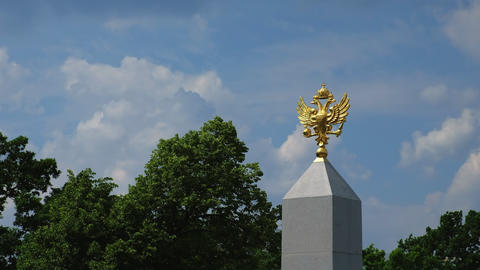 Golden emblem symbol of Russia, against the blue sky. Symbols of the state and Live Action