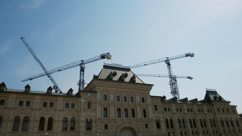 Building construction process. Tower crane construction a modern residential Live Action