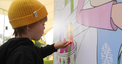 Baby boy have fun to drawing on the wall Footage