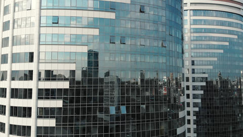 Glass building front view. Reflection on a modern office building. Glass walls Footage