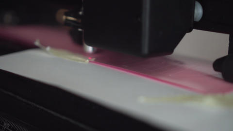 Cutting plotter. Plotter cuts vinyl, film. Laser cuts vinyl, film. Industrial Live Action