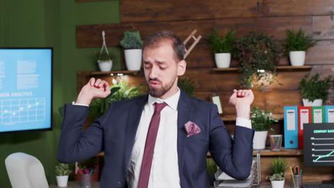 Handheld shot of office worker dancing Footage