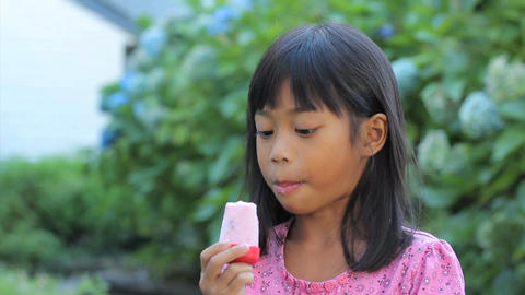 Asian Girl Eating A Popsicle Stock Video Footage