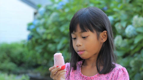Asian Girl Eating A Popsicle Footage