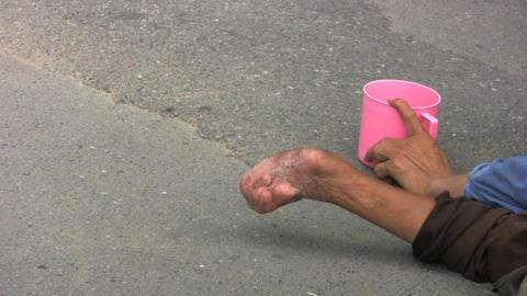 Beggar Looking In Pink Cup Stock Video Footage