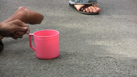 Beggar With A Pink Cup Footage