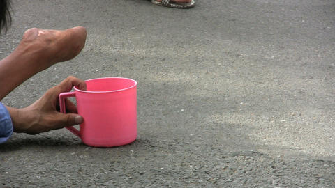 Beggar With A Pink Cup Stock Video Footage