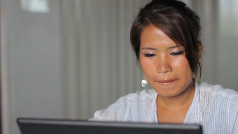 Cute Asian Girl Listens To Music At Work Stock Video Footage