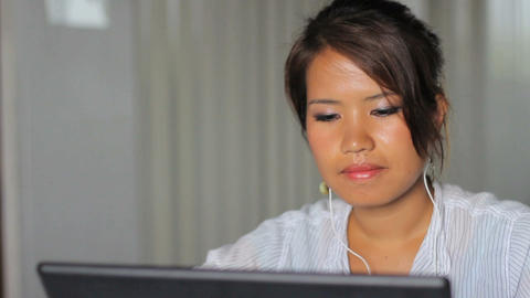 Cute Asian Girl Listens To Music At Work Footage