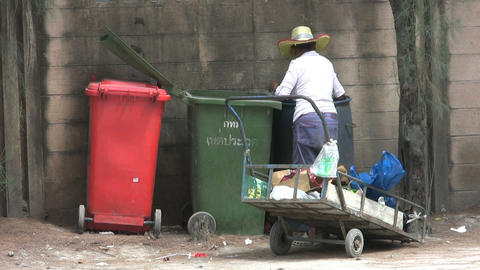 Asian Lady Going Through The Garbage Stock Video Footage