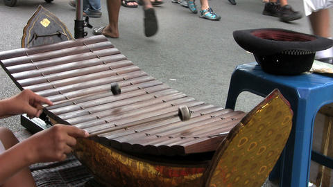 Asian Teen Playing A Wooden Xylophone Footage