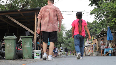 Asian Woman And Man Walk Through Slum Stock Video Footage
