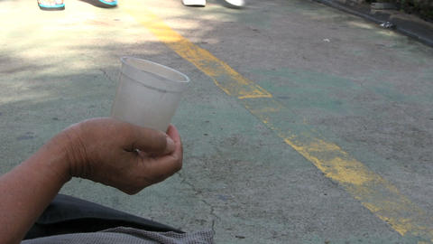 Beggar On Elevated Walkway With Cup Stock Video Footage