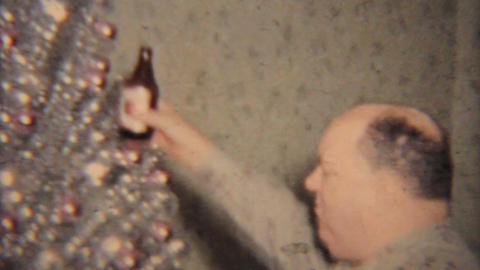 Christmas 1964 Man Drinking Beer At Party Vintage 8mm film Stock Video Footage