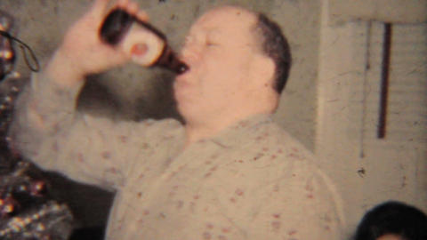 Christmas 1964 Man Drinking Beer At Party Vintage 8mm Film stock footage