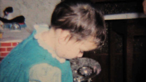 Little Girl Enjoys A Christmas Candy 1964 Vintage 8mm film Stock Video Footage