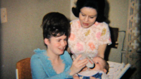 Young Mother Feeds Daughter Her Bottle 1965 Vintage 8mm film Footage