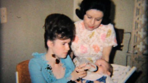 Young Mother Feeds Daughter Her Bottle 1965 Vintage 8mm film Stock Video Footage