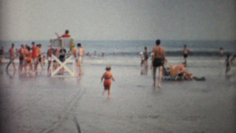 Little Girl Jumps In The Florida Waves 1967 Vintage 8mm film Stock Video Footage