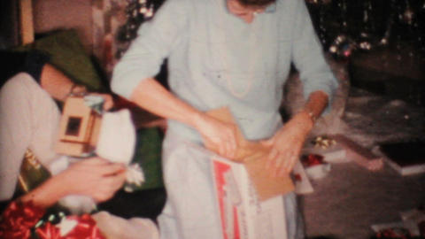 Mom Gets Electric Carving Knife For Christmas 1967... Stock Video Footage