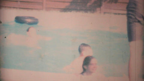 Teenage Girl Gets Thrown In Pool By Boys 1969 Vintage 8mm... Stock Video Footage