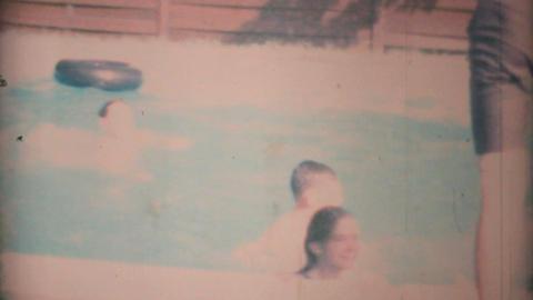 Teenage Girl Gets Thrown In Pool By Boys 1969 Vintage 8mm... Stock Video Footage