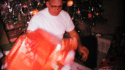 Man Gets New Shirt For Christmas 1967 Vintage 8mm film Stock Video Footage