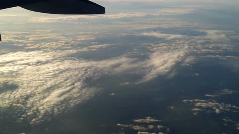Plane flying over the clouds 5 Stock Video Footage