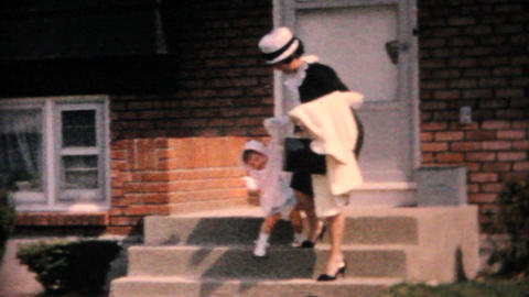 Mother And Daughter In Pretty Easter Outfits 1964 Vintage... Stock Video Footage