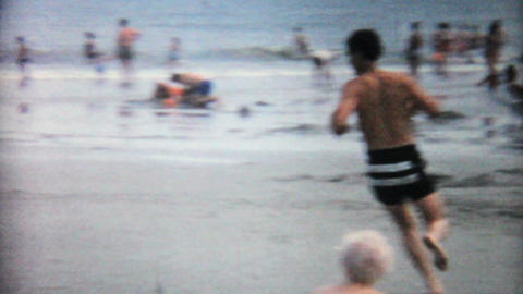 Teenage Boy Running Around On The Beach 1967 Vintage 8mm... Stock Video Footage