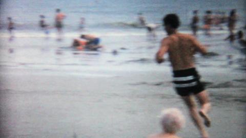 Teenage Boy Running Around On The Beach 1967 Vintage 8mm... Stock Video Footage