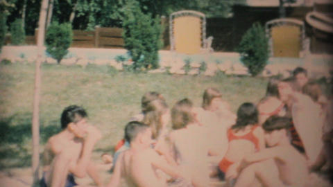 Young Teenagers Enjoy A Barbeque Beside The Pool 1969... Stock Video Footage
