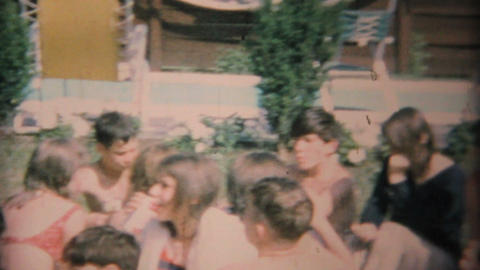Young Teenagers Enjoy A Barbeque Beside The Pool 1969 Vintage 8mm film Footage