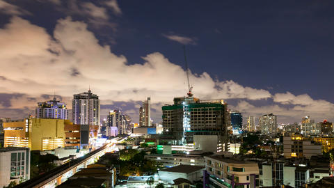 Timelapse - City at night with cloudscape under moonlight Footage