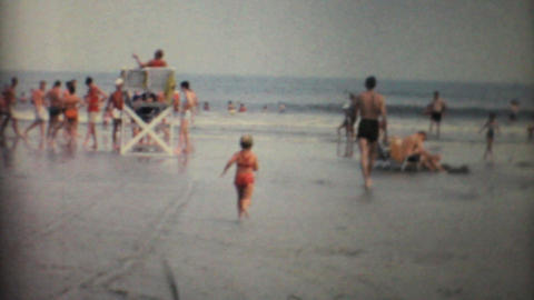 Kids And Families Playing In The Florida Surf 1967... Stock Video Footage