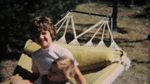Sisters Enjoy Swinging In Hammock 1968 Vintage 8mm film Stock Video Footage